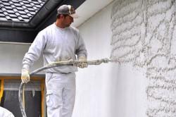 Достоинства машинной штукатурки стен и технология отделки поверхностей